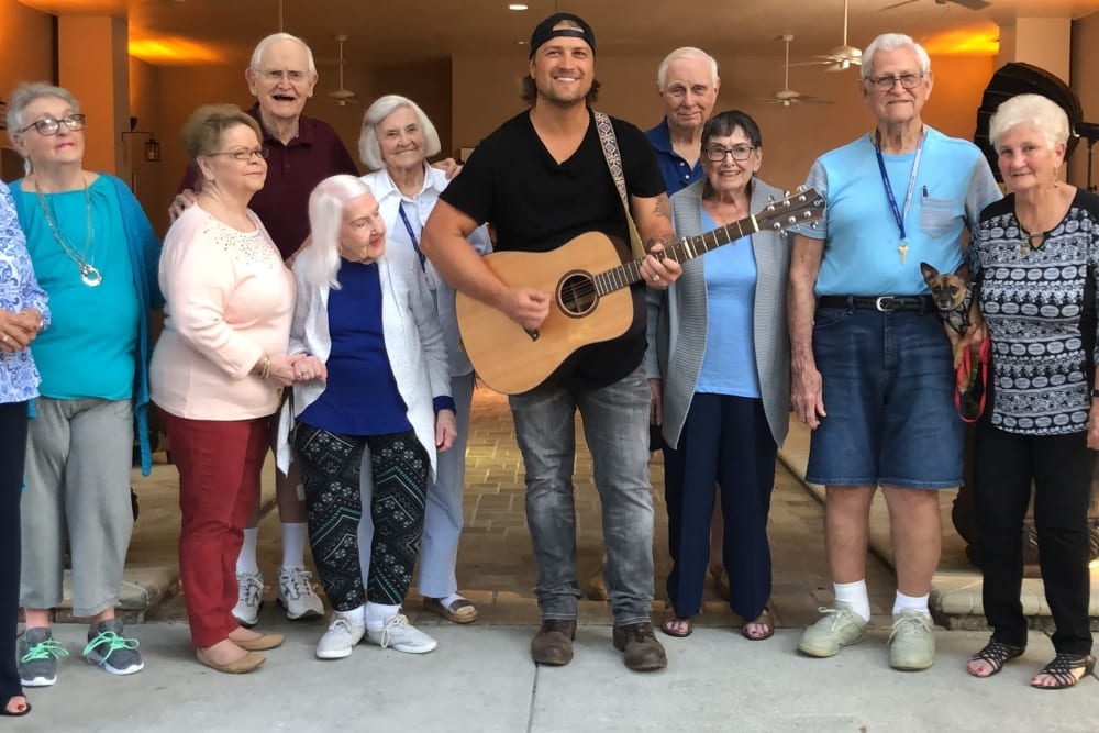 Residents being visited by a musician at The Grande in Brooksville, Florida