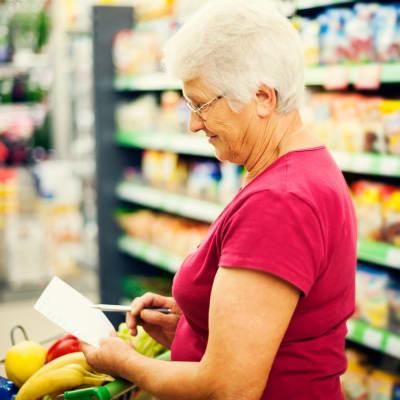A resident shopping for healthy groceries near The Glenn Hopkins