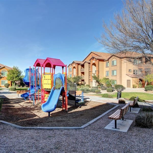 Spacious playground with benches at Tierra Pointe in Casa Grande, Arizona