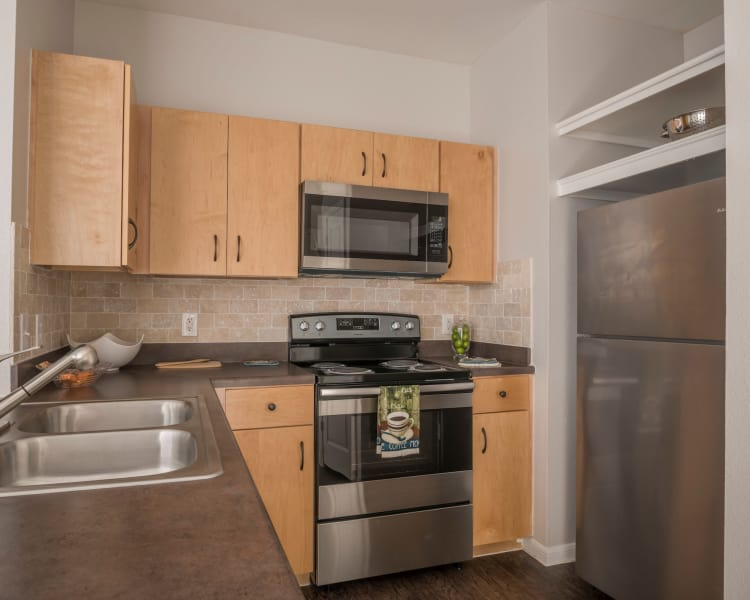 Stainless-steel appliances in a modern kicthen at Cambria Cove Apartments in Houston, Texas