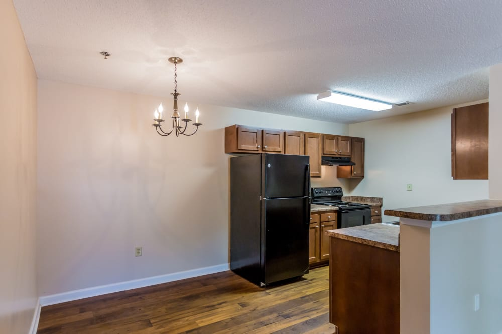 An apartment kitchen and dining room at Park Ridge Apartments in Jackson, Tennessee