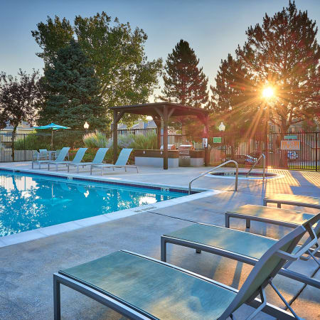Refreshing swimming pool and exterior covered BBQ at Alton Green Apartments in Denver