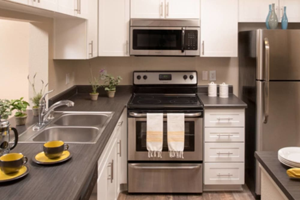 Beautiful, gourmet kitchen in a model home at Alize at Aliso Viejo Apartment Homes in Aliso Viejo, California