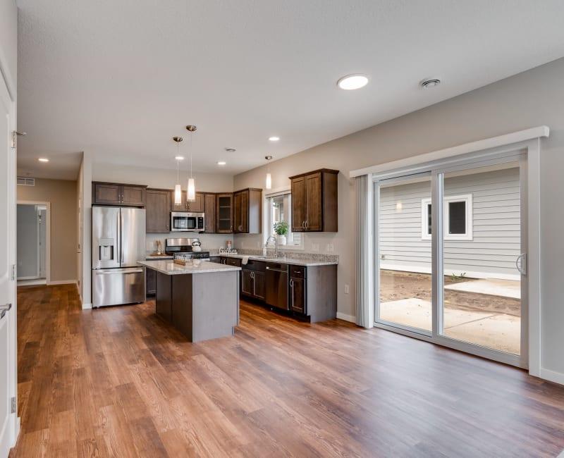 Kitchen with hardwood floors at The Fields at Arbor Glen in Lake Elmo, Minnesota