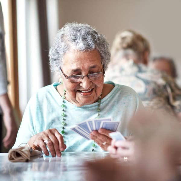 A resident playing a card game at Pacifica Senior Living Menifee in Sun City, California.