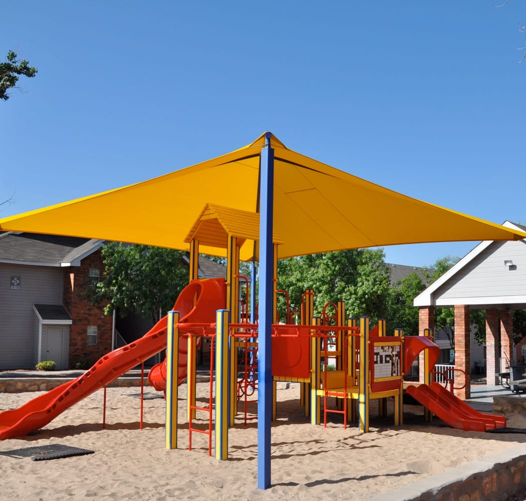 Covered playground at Shadow Ridge Apartments in El Paso, Texas