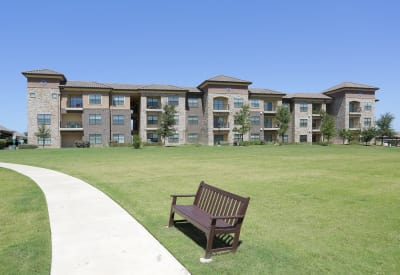 Winding pathway through well-manicured lawn at Evolv in Mansfield, Texas