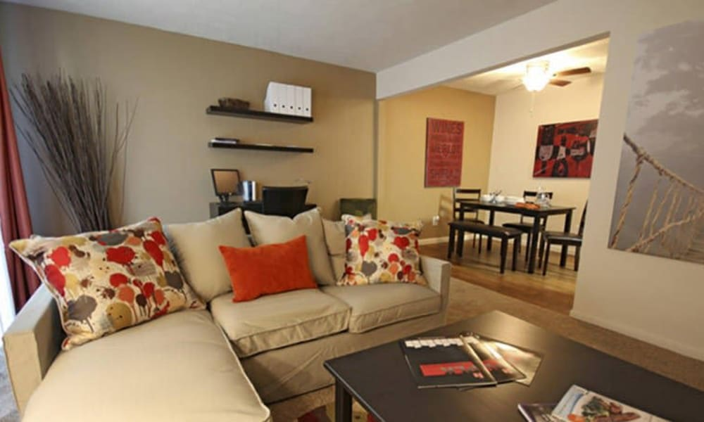 Well-decorated living room and dining area at Lakeside Landing Apartments in Lakeside Park, Kentucky