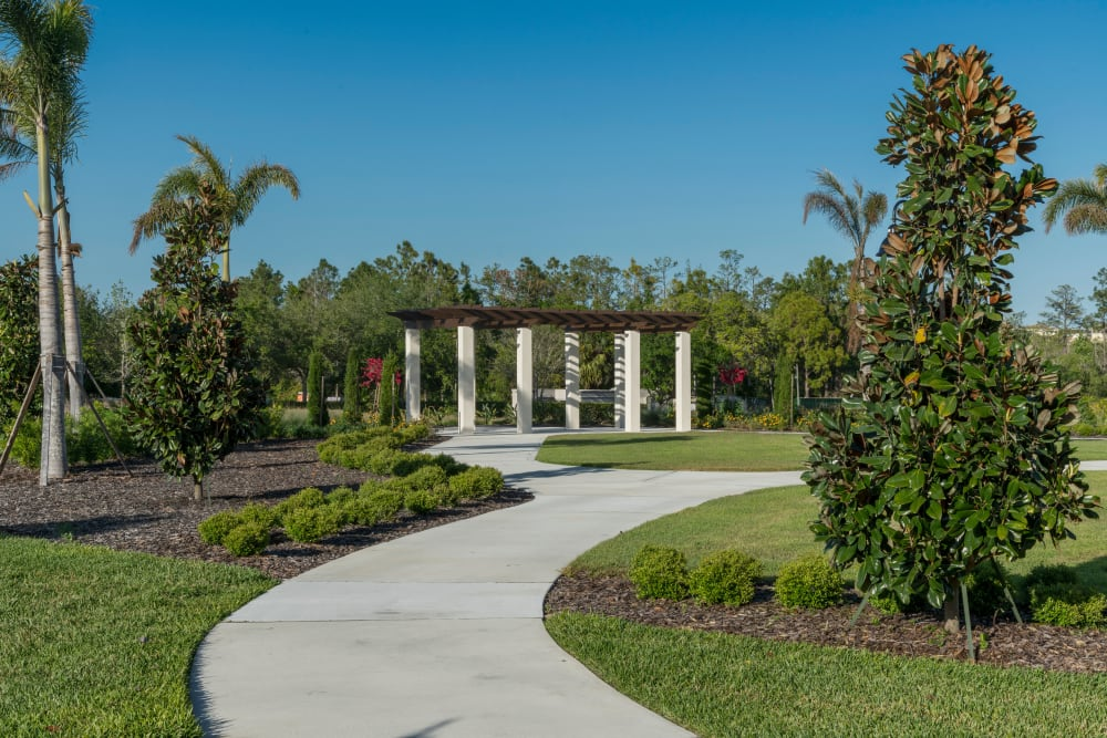 Beautiful landscaping and walking paths at Merrill Gardens at ChampionsGate in ChampionsGate, Florida.