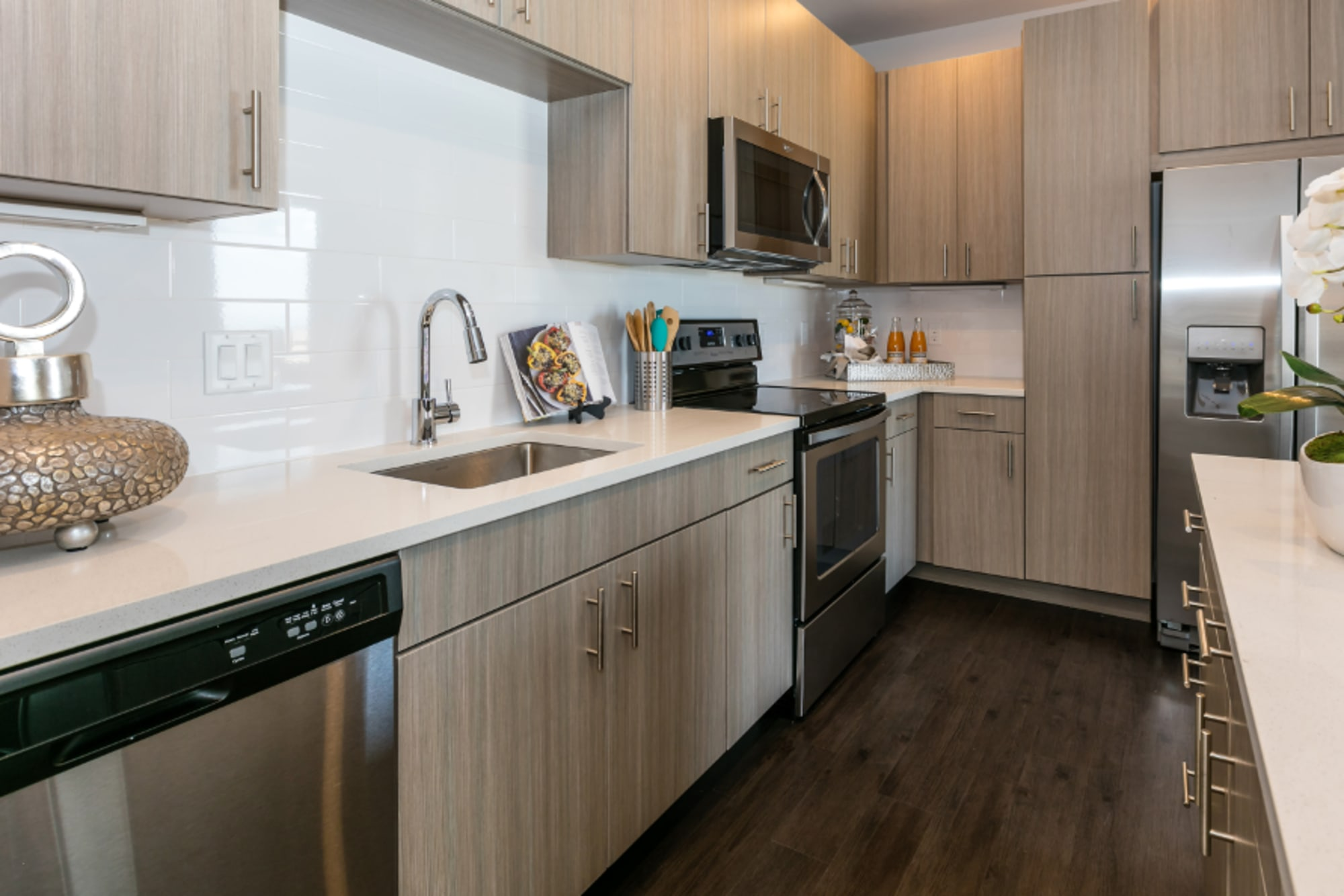 Tile backsplash and cream-colored cabinetry at Strata Apartments in Denver, Colorado