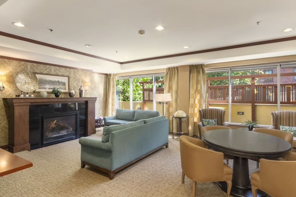 Spacious common area with fireplace at Merrill Gardens at First Hill in Seattle, Washington