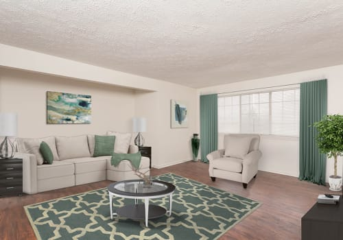 Well-lit Living room at Waverlywood Apartments & Townhomes in Webster, New York