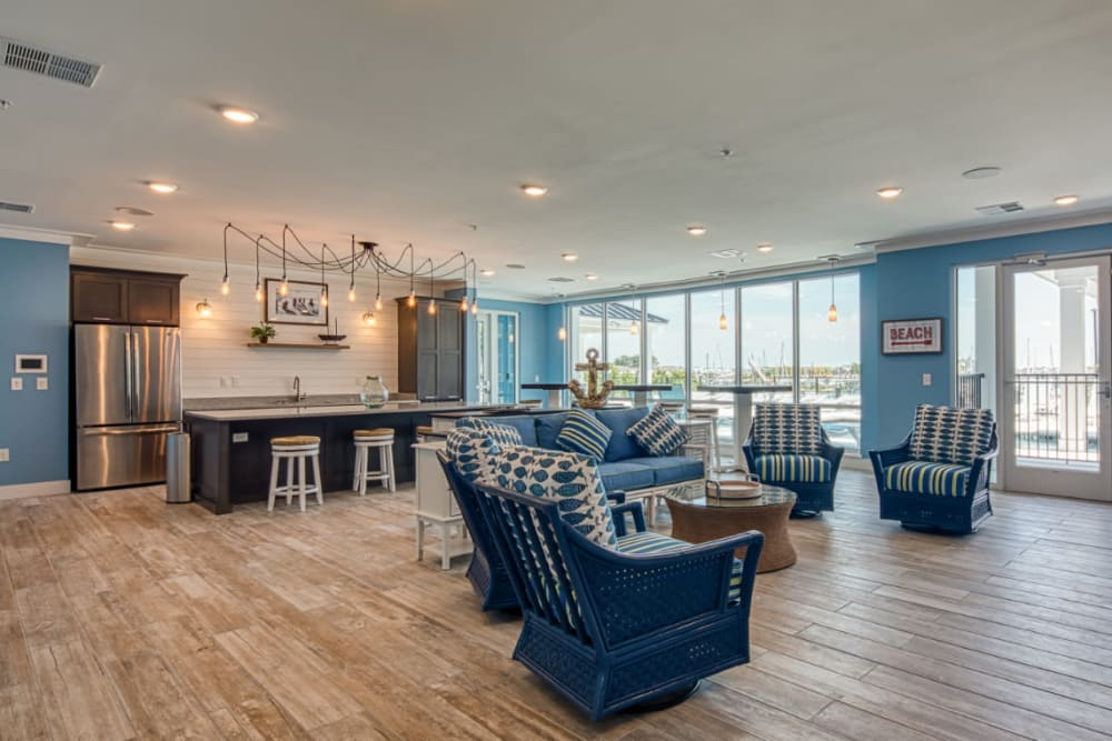 A spacious clubhouse with a view and comfortable seating at Marina Villa in Norfolk, Virginia