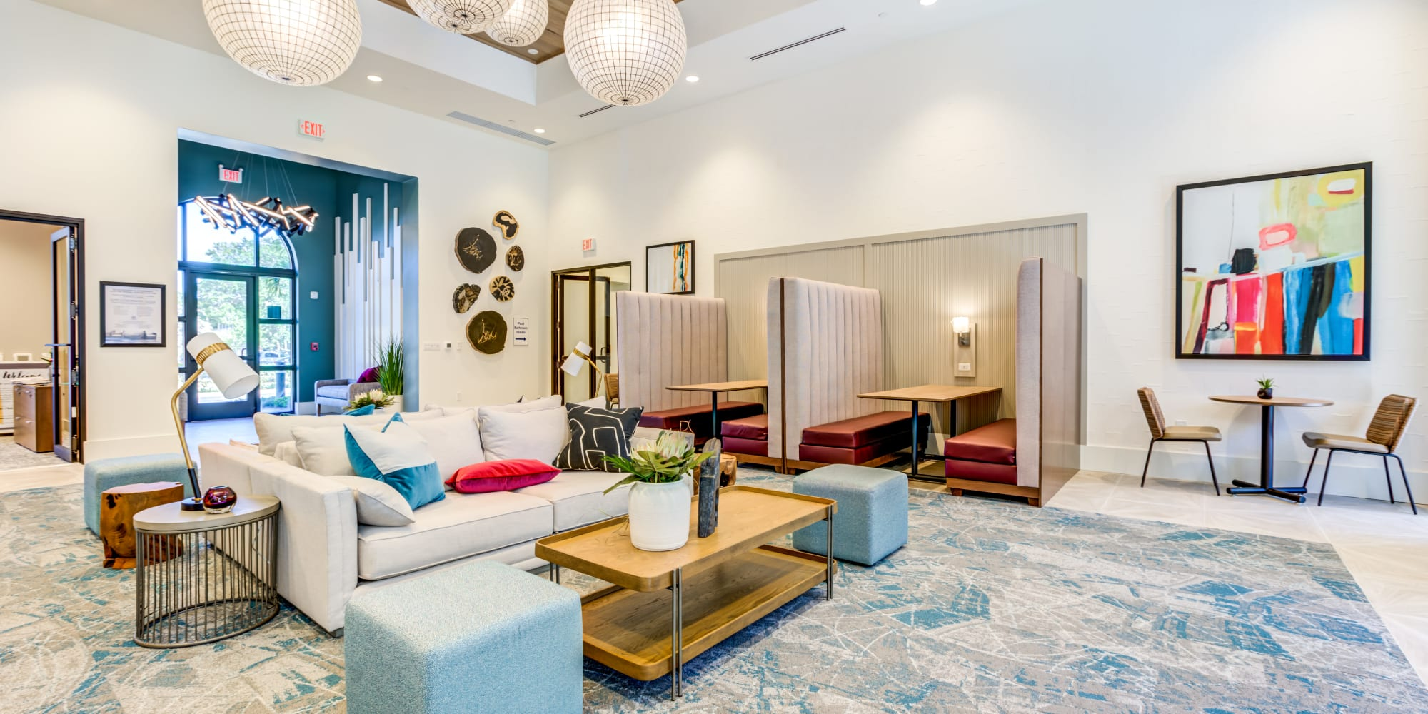 Clubhouse seating area at Solera at City Centre apartments in Palm Beach Gardens, Florida