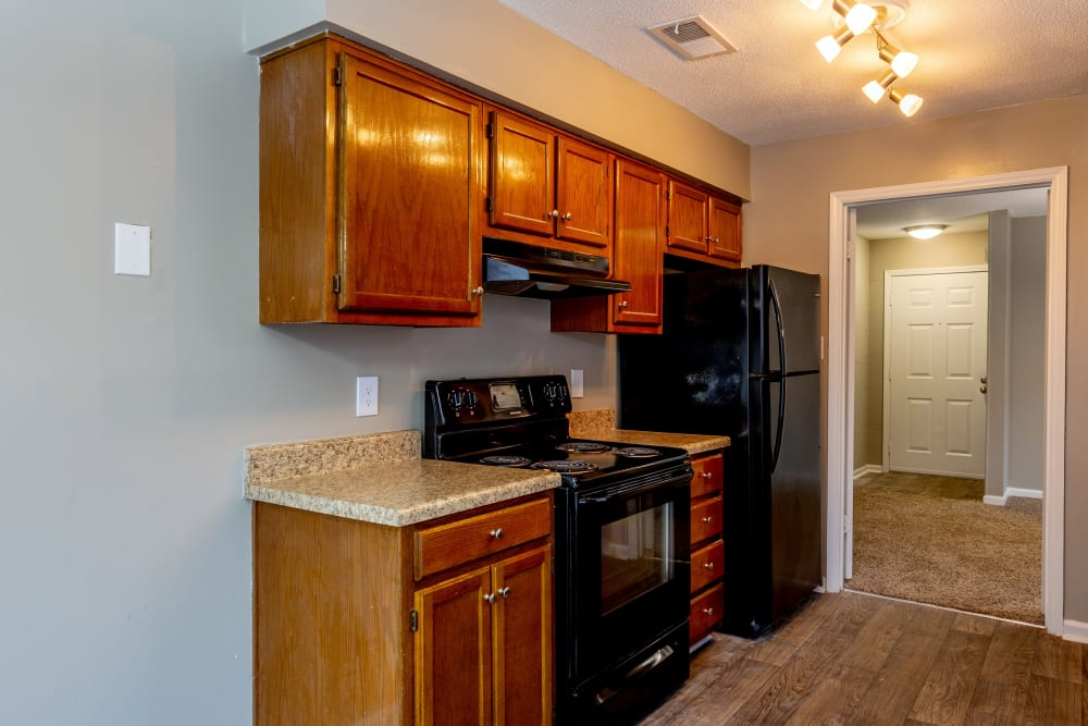 Black kitchen appliances in a model apartment at The Gatsby at Midtown in Montgomery, Alabama