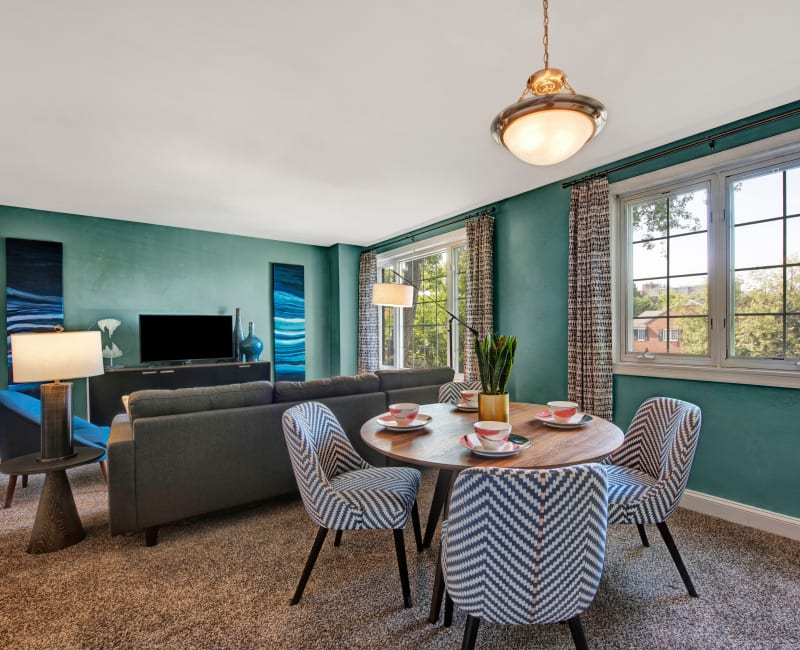 An inviting living room and dining room at Braddock Lee Apartments in Alexandria, Virginia
