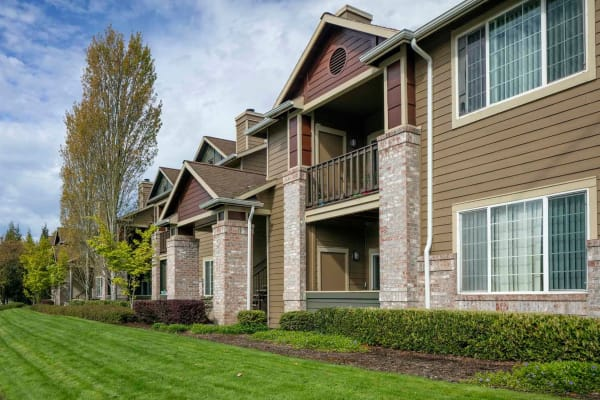 A two story apartment building with well maintained yard at The Grove at Orenco Station in Hillsboro, Oregon