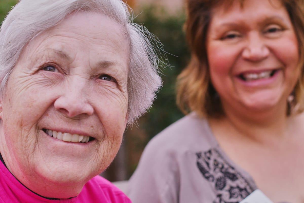 Two residents smiling for the camera at Farmington Square Beaverton in Beaverton, Oregon