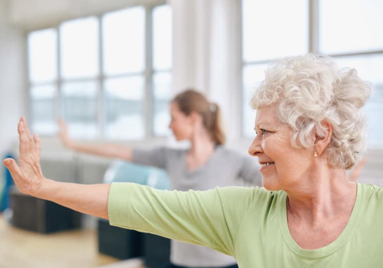Seniors practicing yoga at Highland Glen in Highland, Utah