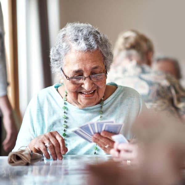A resident playing cards at Kenmore Senior Living in Kenmore, Washington