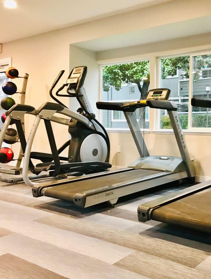 fitness center cardio machines at Bennington Apartments