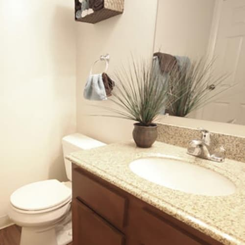 Model bathroom with upscale cabinetry and countertop at Lakeside Landing Apartments in Lakeside Park, Kentucky
