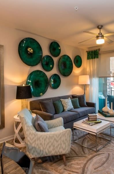 Living room with vibrant decorations at Luxe Scottsdale Apartments in Scottsdale, Arizona