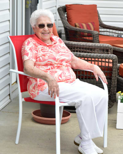 Resident sitting outside at Garden Place Red Bud in Red Bud, Illinois.