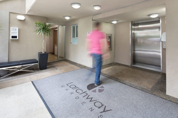 Resident heading towards the elevator at Larchway Gardens in Vancouver, British Columbia