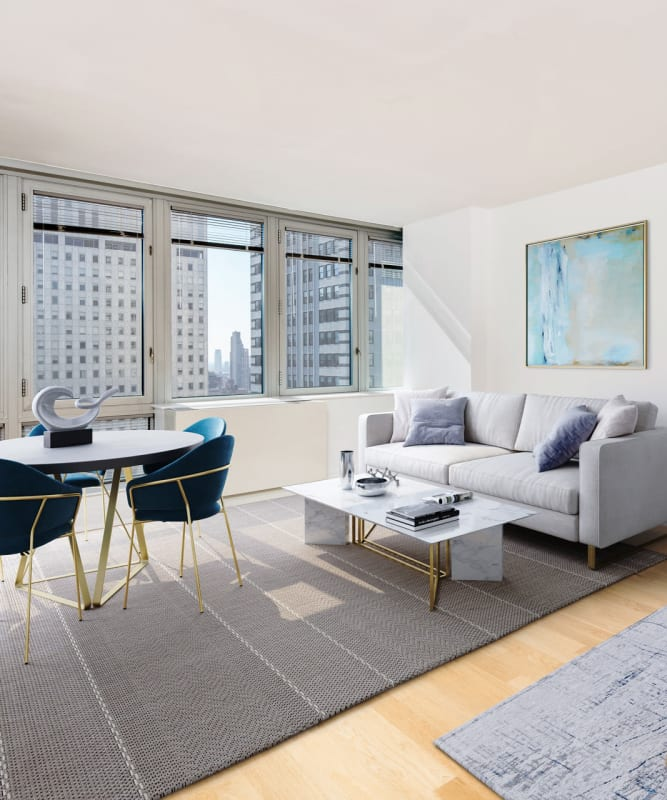 A studio living room with large windows at The Metropolis in New York, New York