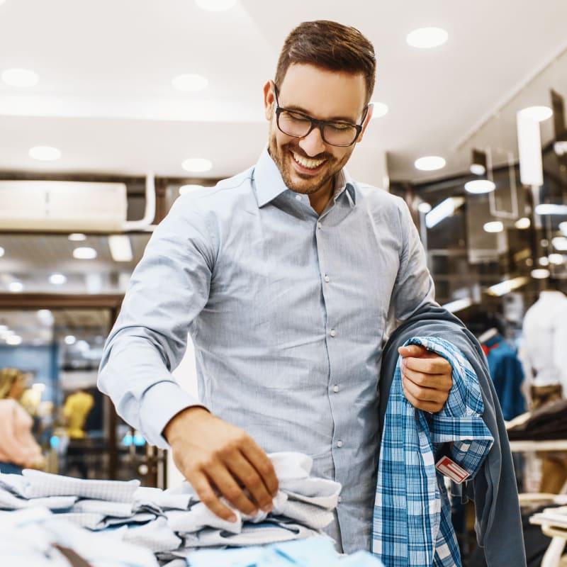 Man shopping for shirts in a men's clothing retailer at Portside Ventura Harbor in Ventura, California