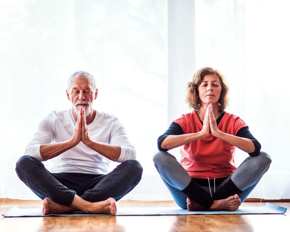 Man and woman doing yoga at The Maven on Broadway in Rochester, Minnesota