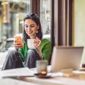 Woman having a coffee near New Medford in Medford, Oregon