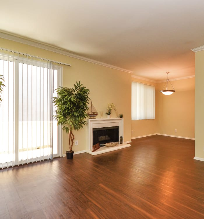 Living room with fireplace and hardwood floors at IMT Beverly Arnaz in Los Angeles, California