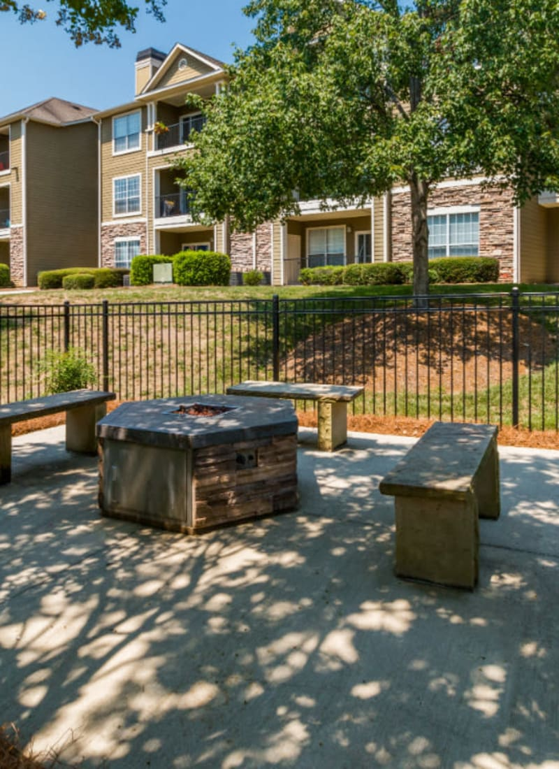 Firepit with stone benches at Marquis at Carmel Commons in Charlotte, North Carolina