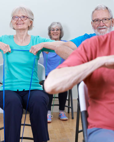 Residents participate in an exercise class at Lassen House Senior Living in Red Bluff, California