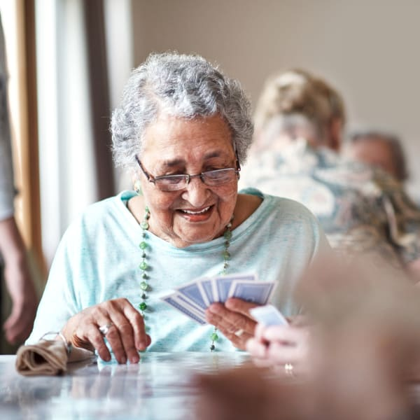 A resident looking at her cards at Pacifica Senior Living Menifee in Sun City, California.