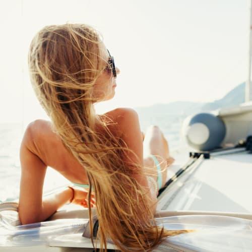 Resident enjoying the view from a boat near Portside Ventura Harbor in Ventura, California