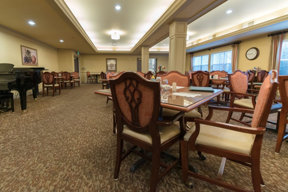 Resident dining hall with restaurant-style seating at Kenmore Senior Living in Kenmore, Washington
