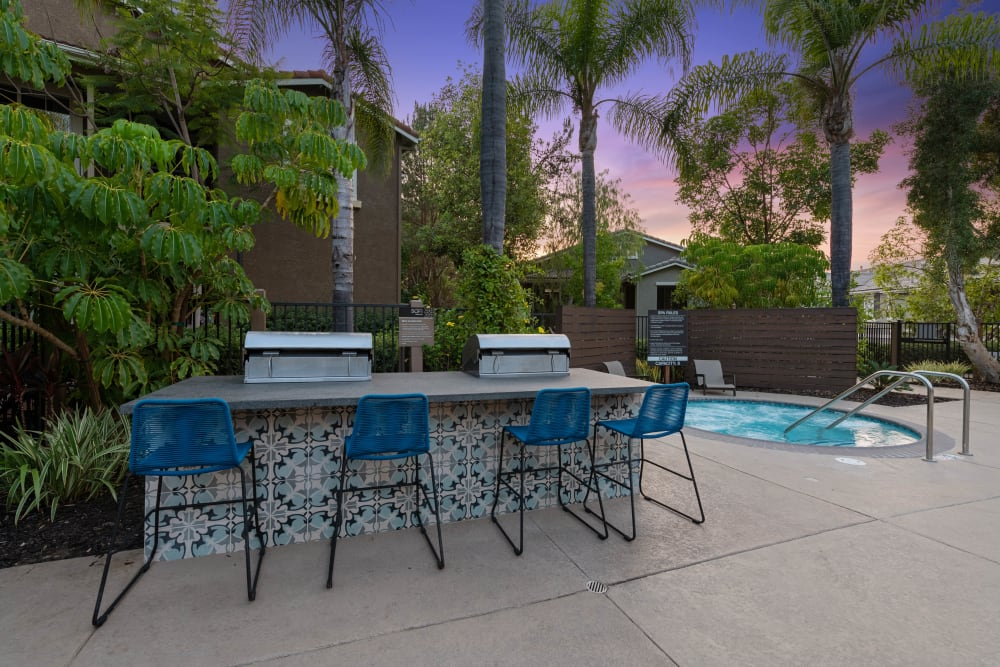 Barbecue area with gas grills near the spa at Sofi Westview in San Diego, California