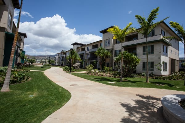 Well-maintained landscaping surrounding resident buildings at Kapolei Lofts in Kapolei, Hawaii
