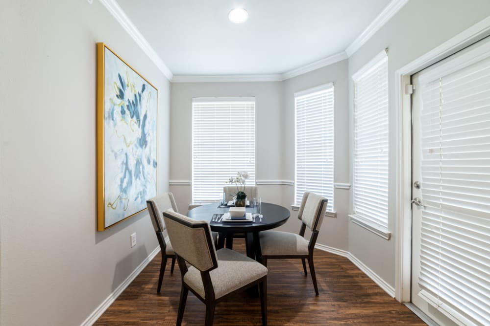 Dining room with several windows at Marquis at Bellaire Ranch in Fort Worth, Texas