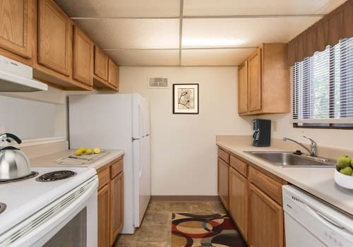 Modern, bright kitchen at High Acres Apartments & Townhomes home in Syracuse, New York