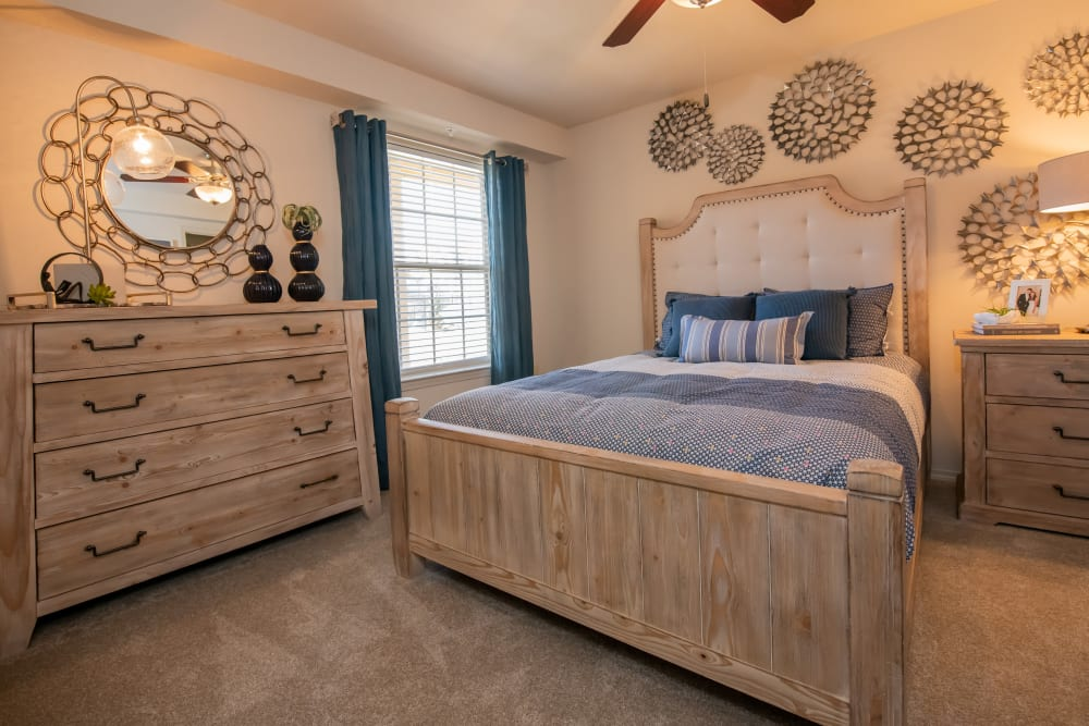 Bright primary bedroom at Portico at Friars Creek Apartments in Temple, Texas