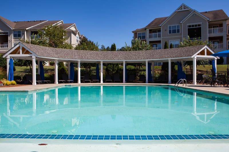 Big gazebo near outdoor pool at Belle Vista Apartment Homes in Lithonia, Georgia