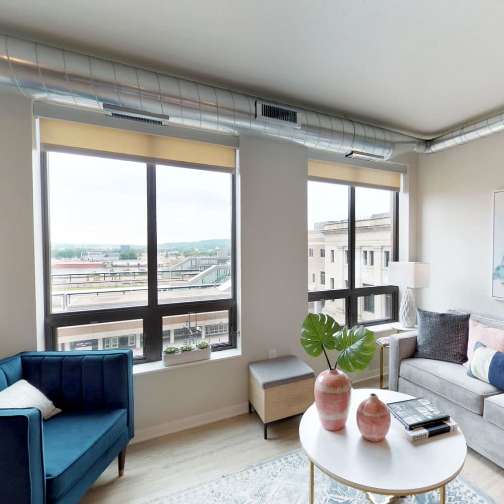 Bay windows with a terrific view of the city from a model home's well-furnished living area at Oaks Union Depot in St. Paul, Minnesota