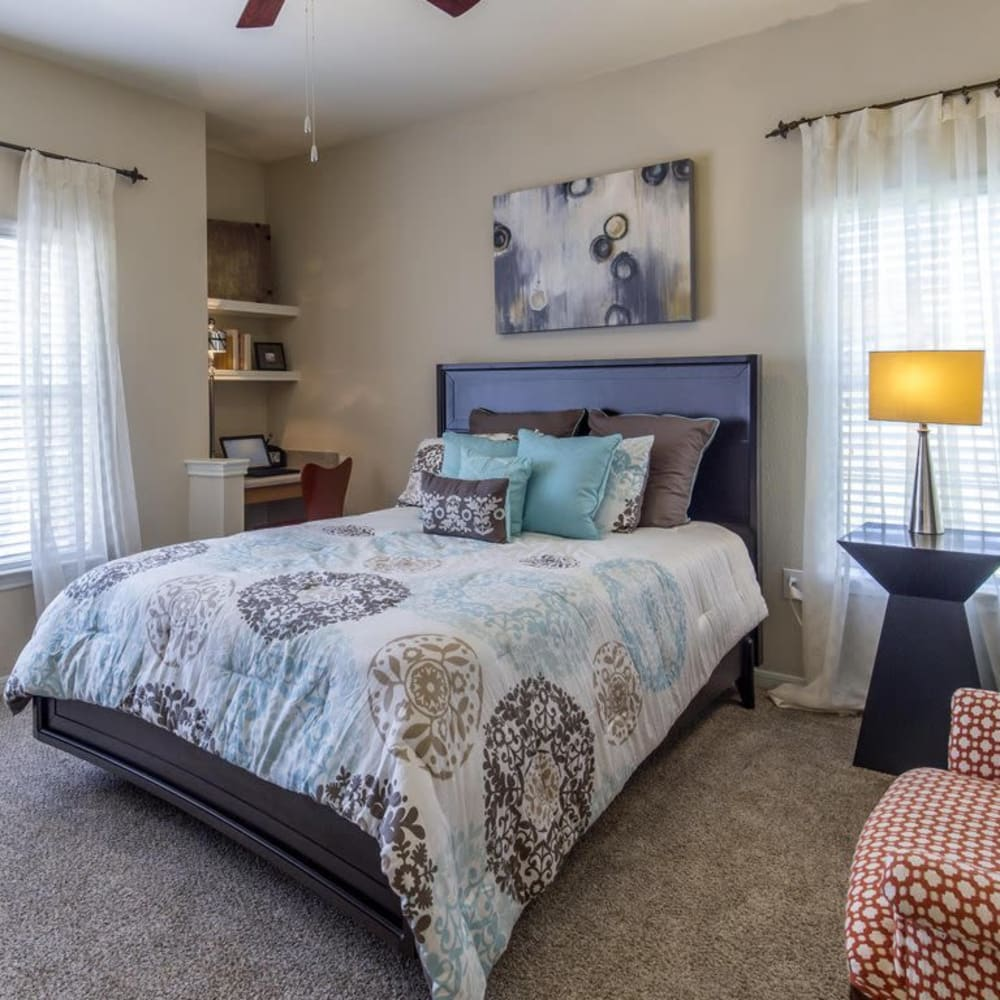 Master bedroom with a ceiling fan and plush carpeting at Ranch at Hudson Xing in McKinney, Texas