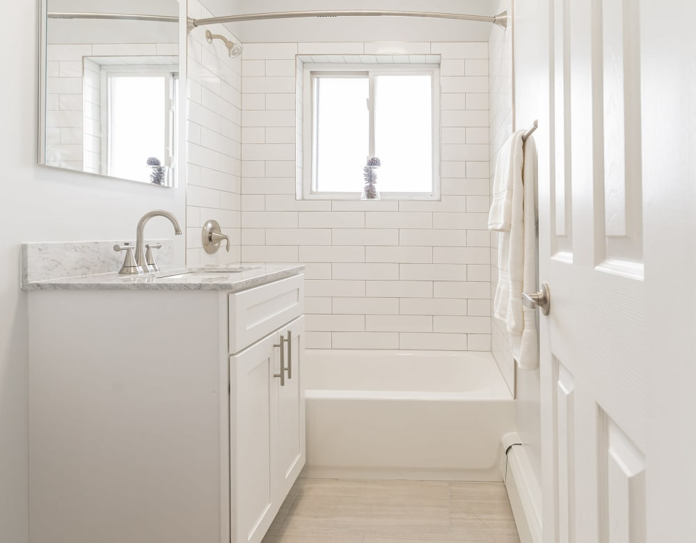White Bathroom at Brixton Lane in Levittown, New York