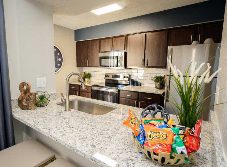 Spacious kitchen with ample counter space and custom cabinetry at Laurel Heights at Cityview in Fort Worth, Texas