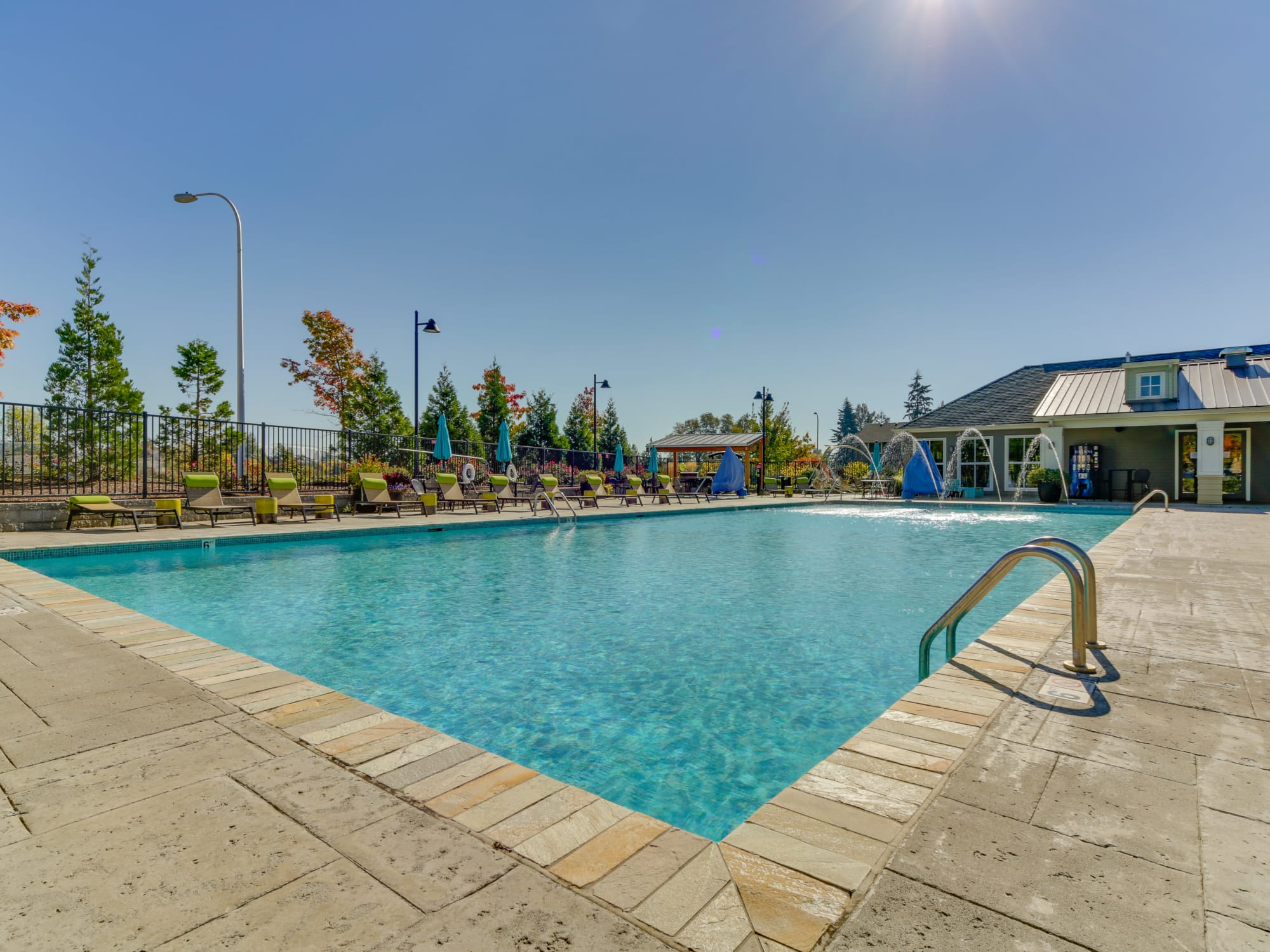 Beautiful Sparkling pool with lounges, fountains spraying into pool, spa, BBQ area in Wilsonville, OR